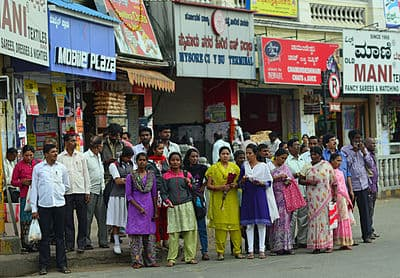 Pedestrians waiting at crossing, Mysore.jpg